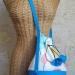 sac , chute de  caoutchouc bleu , tissu imptimé